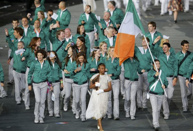 Ireland's flag bearer Taylor holds the national flag as he leads the contingent in the athletes parade during the opening ceremony of the London 2012 Olympic Games at the Olympic Stadium