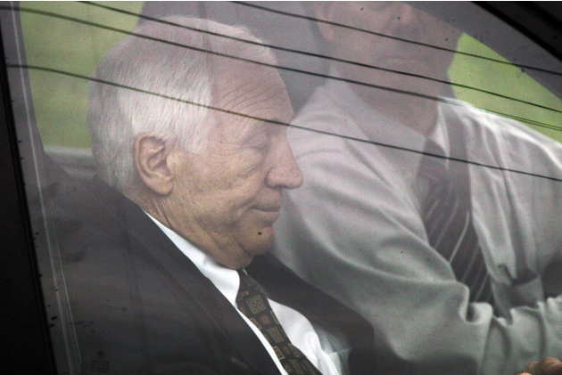 Former Penn State University assistant football coach Jerry Sandusky, left, arrives with his attorney Joe Amendola for the second day his trial at the Centre County Courthouse in Bellefonte, Pa., Tues