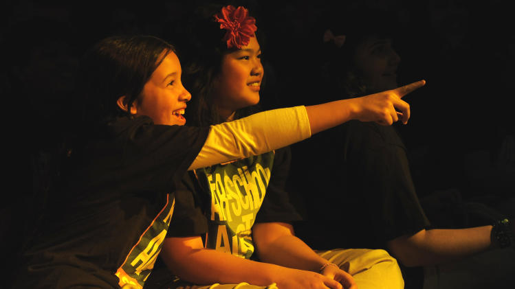 Students of After-School All-Stars at a private concert presented by tour sponsors MetroPCS & ZTE, on Monday, February, 11, 2013 at the El Rey Theatre in Los Angeles. (Photo by Chris Pizzello/Invision for MetroPCS/AP Images)