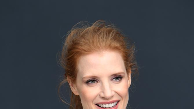 Jessica Chastain poses for photographers as she arrives for Chanel's Fall/Winter 2013-2014 ready to wear collection, in Paris, Tuesday, March, 5, 2013. (AP Photo/Thibault Camus)