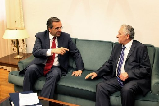 <p>Leader of the New Democracy conservative party Antonis Samaras (L) meets with Democratic Left party leader Fotis Kouvelis at the Greek parliament, in Athens, on June 18. Greece on Wednesday was close to forming a coalition to revise an unpopular EU-IMF bailout deal and pull the country out of a harrowing recession that has doomed its economic recovery efforts.</p>