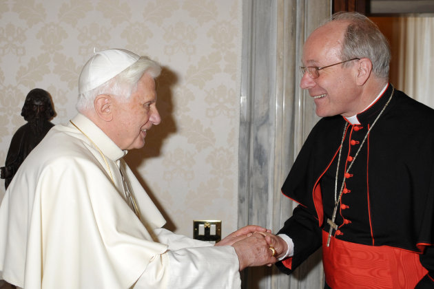 FILE -- In this file picture taken at the Vatican on June 28, 2010 and made available by the Vatican newspaper Osservatore Romano, Pope Benedict XVI, left, shakes hands with Vienna's archbishop, Cardi
