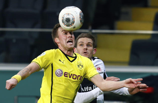 Borussia Dortmund's Grosskreutz challenges Eintracht Frankfurt's Jung during their German soccer cup (DFB Pokal) quarter-final soccer match in Frankfur