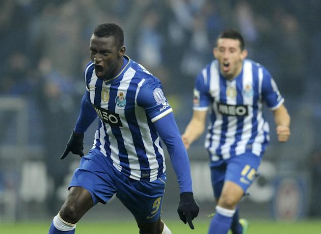 FC Porto's Jackson Martinez, from Colombia, celebrates with Hector Herrera from Mexico, rear, after scoring the opening goal against Sporting Braga in a Portuguese League soccer match at the Draga