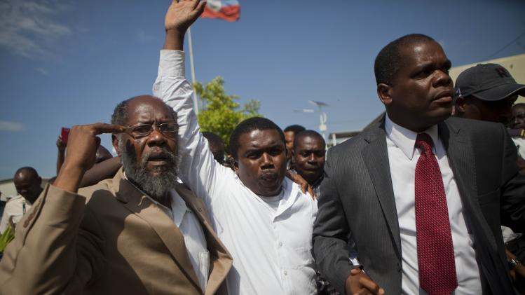 Backers spring Haiti lawyer in corruption cases