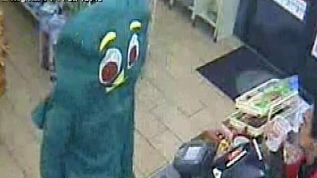 In this surveillance video taken Sept. 5, 2011 and released by the San Diego Police Department showing a suspect dressed like Gumby telling a convenience store clerk he is being robbed, fumbling inside the costume as if to pull a gun, dropping 27 cents and leaving. Police say the attempted robbery took place Monday Sept. .5, 2011 at a 7-Eleven in Rancho Penasquitos, Calif. (AP/Photo/Siego Police Department)