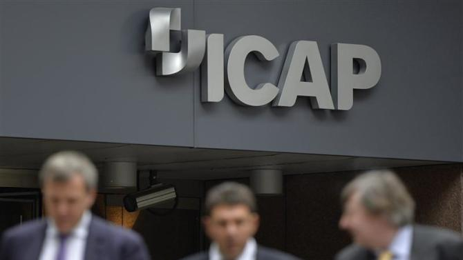 People walk past an ICAP office in the City of London