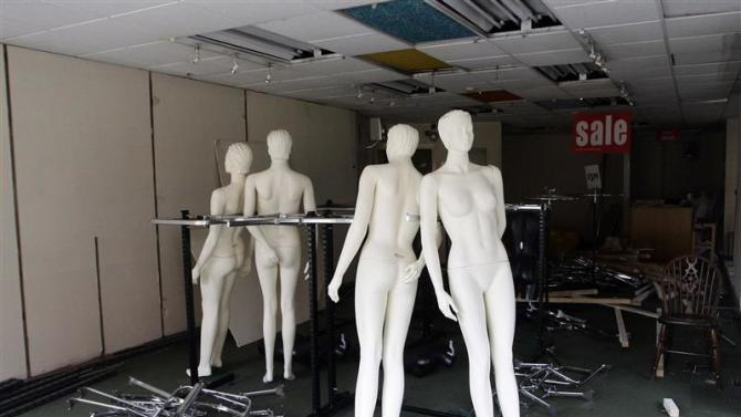 File picture shows mannequins in a closed clothes shop in Derby