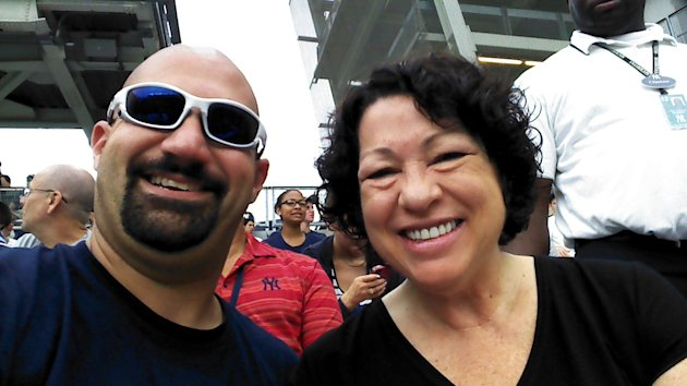 "In this cell phone image provided by ""Bald Vinny"" Milano, Supreme Court justice and Bronx native Sonia Sotomayor, right, and Milano smile for a photo during a baseball game between the New York Yankees and Baltimore Orioles, Wednesday, Aug. 1, 2012 at Yankee Stadium in New York. Sotomayor sat in Section 203 of the right-field stands for the first-inning ""Roll Call"" of New York's starting lineup. (AP Photo/""Bald Vinny"" Milano)"