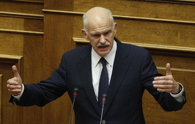 Greek Prime Minister George Papandreou speaks during a parliament session in Athens, Thursday, Nov. 3, 2011. Papandreou abandoned his explosive plan to put a European rescue deal to popular vote Thursday, keeping his government alive _ but passionate squabbling in Athens left the country's solvency in doubt and the eurozone in turmoil. Greek Prime Minister reversed course after a rebellion within his own Socialist party over the referendum, but ignored repeated calls to resign and call elections.(AP Photo/Petros Giannakouris)