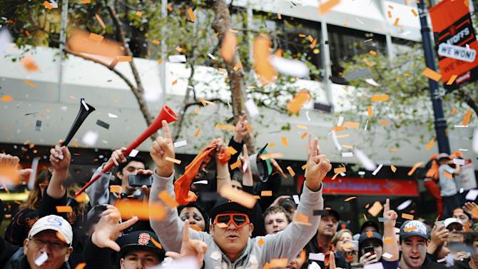People cheer San Francisco Giants pitcher Tim Lincecum as he passes in the baseball team's World Series victory parade on Market Street, Wednesday, Oct. 31, 2012, in San Francisco. The team's second championship parade in three years went along Market Street and ended with a celebration in front of City Hall. (AP Photo/Nic Coury)