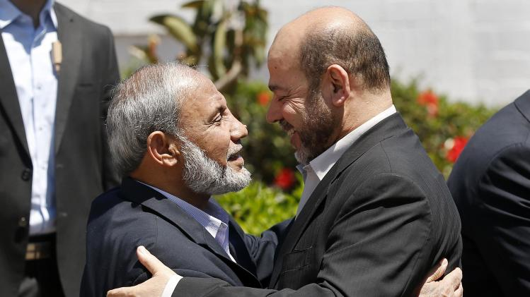 Senior Hamas leader Abu Marzouk hugs fellow Hamas leader Zahar in Gaza City