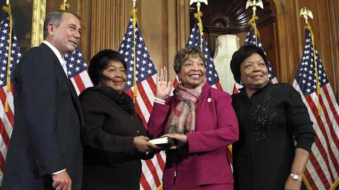 FILE - In this Jan. 5, 2011 file photo, House Speaker John Boehner of Ohio participates in a ceremonial swearing in with Rep. Eddie Bernice Johnson, D-Texas, second from right, on Capitol Hill in Washington. For two decades, Eddie Bernice Johnson has been an outspoken voice for Democrats in a bright blazer and multicolored scarf. But for the first time, the first black woman to represent North Texas in Congress is facing serious opposition in this month's primary. And the effort to unseat her is just one of several challenges being mounted against some of the longest-serving blacks in Congress.  (AP Photo/Jacquelyn Martin, File)