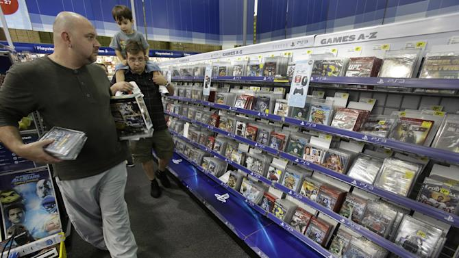 Shoppers look for bargains in the video game section of a Best Buy store in Orlando, Fla., during the final days leading up to Christmas, Thursday, Dec. 20, 2012.  (AP Photo/John Raoux)