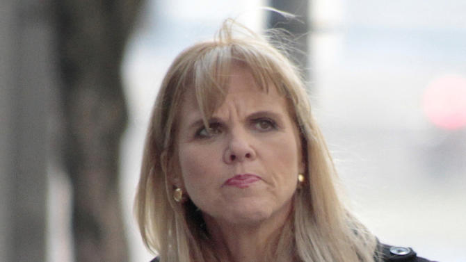 FILE - In this file photo from March 2, 2011, Pennsylvania state Sen. Jane Orie, R-Allegheny, heads back to court in Pittsburgh for her first trial on charges of using her staff for campaign work. Legal experts say Orie could learn that cover-ups are often more damaging than the underlying crimes when she's sentenced Monday, June 4, 2012, on charges she used her state-funded legislative staff to perform campaign work and covered up her misdeeds with forged documents. (AP Photo/Keith Srakocic, File)