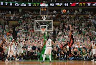 Dwyane Wade goes for the win with this three-point attempt near the end of OT. He missed it, allowing the Celtics to escape with a two-point victory. (Getty Images)