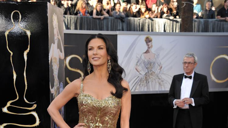Actress Catherine Zeta-Jones arrives at the Oscars at the Dolby Theatre on Sunday Feb. 24, 2013, in Los Angeles. (Photo by John Shearer/Invision/AP)