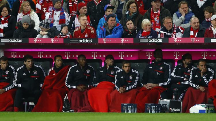 Munich's substitute players follow the German first division Bundesliga soccer match between Bayern Munich and Leverkusen in Munich
