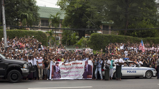 A crowd gathers across the street from the residence of Myanmar opposition leader Aung San Suu Kyi during a visit by U.S. President Barack Obama in Yangon, Myanmar, Monday, Nov. 19, 2012. Obama who touched down Monday morning, becoming the first U.S. president to visit the Asian nation also known as Burma, said his historic visit to Myanmar marks the next step in a new chapter between the two countries. (AP Photo/Carolyn Kaster)