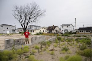 Joe Quinn visits the remains of his parents home that…