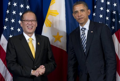 US President Barack Obama poses with Philippine President Benigno Aquino (L) during their meeting in 2011. Both urged a peaceful resolution of disputes on the South China Sea, amid high tension between Beijing and Manila