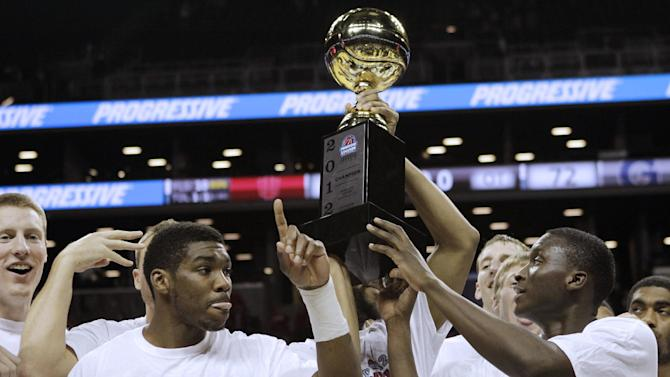 Indiana guard Remy Abell (23) and guard Victor Oladipo (4) celebrate with the trophy after defeating Georgetown in the championship game of Round 2 in the Legends Classic NCAA college basketball tournament at the Barclays Center, early Wednesday, Nov. 21, 2012, in New York. (AP Photo/Kathy Willens)