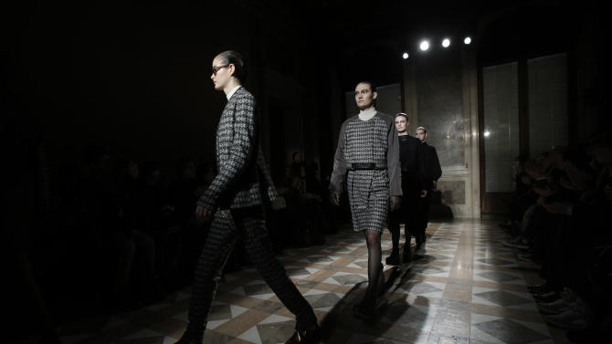 Models present creations for Damir Doma's Ready to Wear's Fall-Winter 2013-2014 fashion collection, presented, Wednesday, Feb.27, 2013 in Paris. (AP Photo/Christophe Ena)