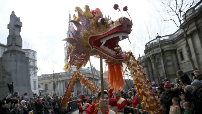 Performers carry a traditional dragon figure at an event to celebrate Chinese New Year in London