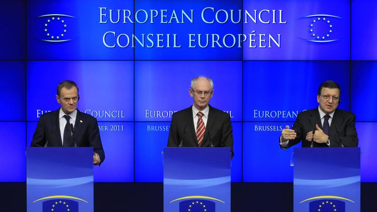 File photo shows Poland's PM Tusk, European Council President Van Rompuy and European Commission President Barroso holding a joint news conference after a European Union leaders summit in Brussels