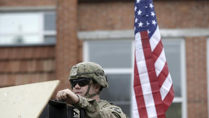 U.S. soldier sits in his Humvee vehicle during the NATO Force Integration Unit inauguration event in Vilnius