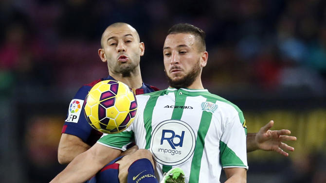 Barcelona's Mascherano fights for the ball against Cordoba's Ghilas during their Spanish First division soccer match in Barcelona