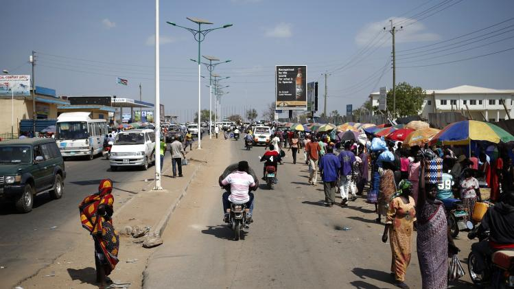 People walk in a street in Juba