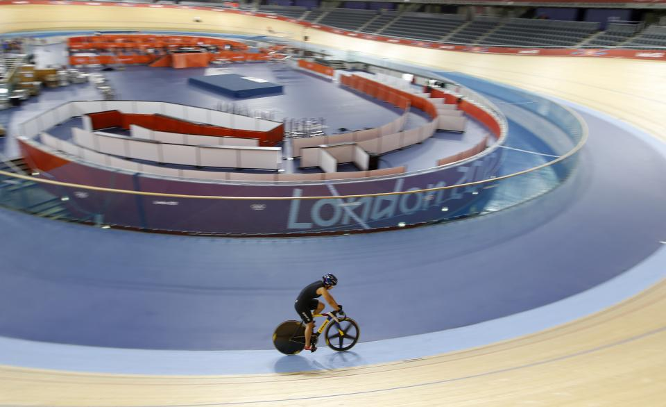 A Chinese cyclist trains at the Velodrome at the Olympic Park, Saturday, July 21, 2012, in London. Opening ceremonies for the 2012 London Olympics will be held Friday, July 27. (AP Photo/Jae C. Hong)