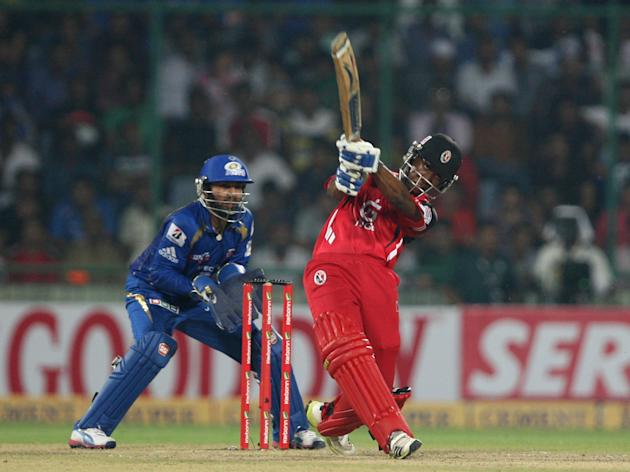 T&T batsman in action during the 2nd CLT20 semi-final match between Mumbai Indians and Trinidad & Tobago at Feroz Shah Kotla, Delhi on Oct. 5, 2013. (Photo: IANS)