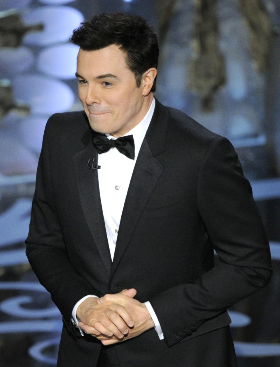 Host Seth MacFarlane performs onstage during the Oscars at the Dolby Theatre on Sunday Feb. 24, 2013, in Los Angeles.  (Photo by Chris Pizzello/Invision/AP)