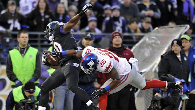 New York Giants free safety Antrel Rolle (26) knocks Baltimore Ravens running back Bernard Pierce, left, out of bounds as Pierce was rushing the ball in the first half of an NFL football game in Baltimore, Sunday, Dec. 23, 2012. (AP Photo/Gail Burton)
