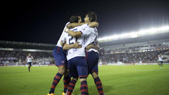 Oscar Romero of Paraguay's Cerro Porteno, right, celebrates with his teammates after scoring against Argentina's Lanus during a Copa Sudamericana soccer match in Buenos Aires, Argentina, Tuesday, Oct. 21, 2014. (AP Photo/Natacha Pisarenko)