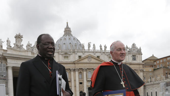 Tanzanian Cardinal Polycarp Pengo, left, and Canadian Cardinal Marc Ouellet as they leave after a cardinals' meeting,  the Vatican, Thursday, March 7, 2013. Cardinals from around the world are gathered inside the Vatican on the fourth day of meetings before the conclave to elect the next pope, amid scandals inside and out of the Vatican and the continued reverberations of Benedict XVI's decision to retire. (AP Photo/Alessandra Tarantino)