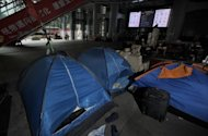 Tents and belongings of the anti-capitalist 'Occupy' movement in Hong Kong, seen here on the ground level of the HSBC building in Hong Kong, on June 25. HSBC on Monday sought legal permission to evict the protesters, one of the last remnants of the 'Occupy' movement in Asia