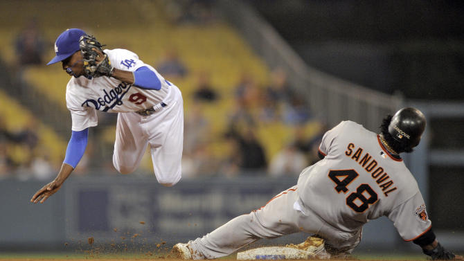 San Francisco Giants' Pablo Sandoval slides into second after being forced out by Los Angeles Dodgers shortstop Dee Gordon on a ball hit by Aubrey Huff during the fourth inning of a baseball game Thursday, Sept. 22, 2011, in Los Angeles. Huff was safe at first. (AP Photo/Mark J. Terrill)