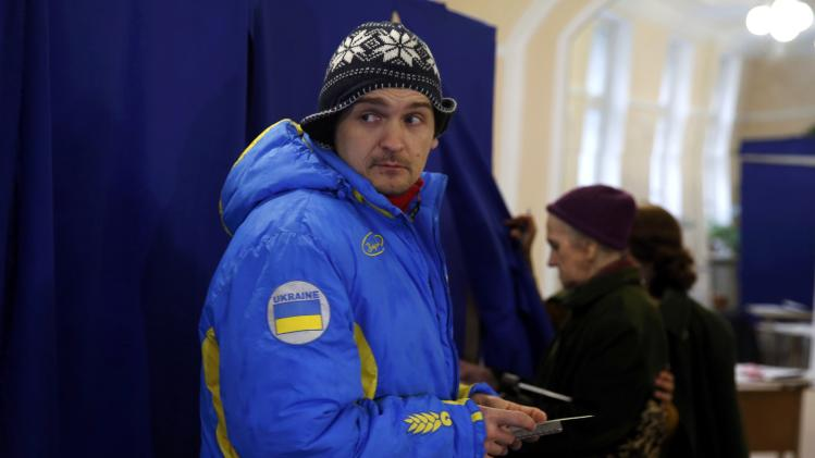 A man prepares to vote during the referendum on the status of Ukraine's Crimea region at a polling station in Sevastopol