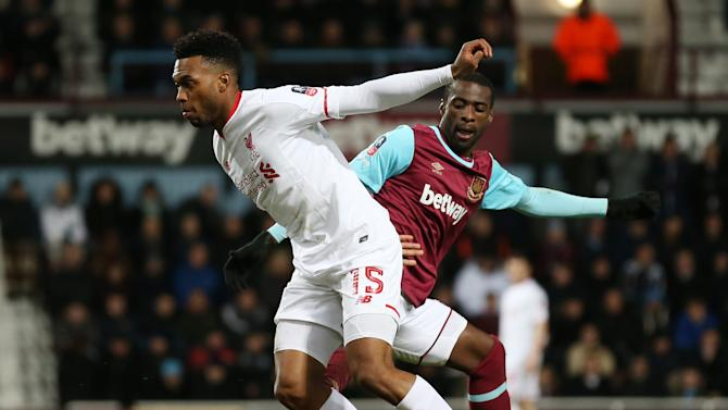 Liverpool's Daniel Sturridge in action with West Ham's Pedro Obiang