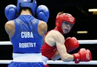 El irlands Michael Conlan (D) se enfrenta al cubano Robeisy Ramrez durante la semifinal de -52 kilos, el 10 de agosto de 2012. El ltimo programa de finales del torneo arranca en el ExCel Arena del este de Londres desde las 13:30 locales, con cinco peleas por las medallas de oro de las divisiones de los 52, 60, 69, 81 y ms de 91 kilogramos. (AFP | jack guez)