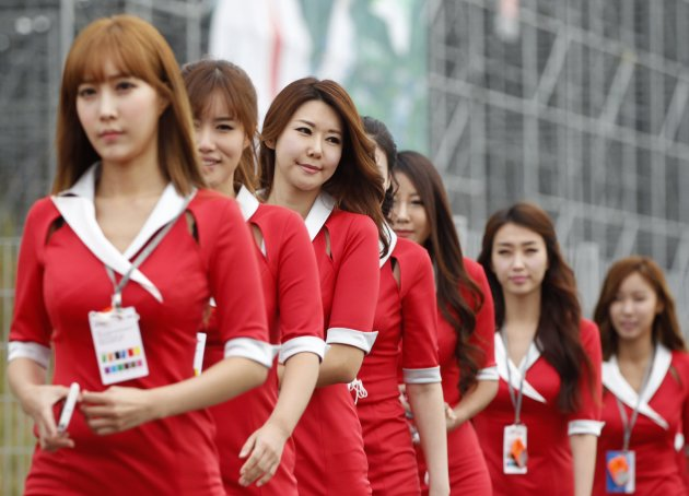 Grid girls arrive at the paddock prior to the South Korean F1 Grand Prix at the Korea International Circuit in Yeongam
