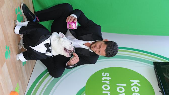 Val Chmerkovskiy of Dancing with the Stars, and his English Bulldog, Sir Sleep, join Procter & Gamble in New York on Wednesday, June 19, 2013, to celebrate The #EverydayEffect campaign, which aims to show consumers how P&G brands improve their everyday lives in small, yet meaningful ways. (Photo by Diane Bondareff/Invision for P&G/AP Images)