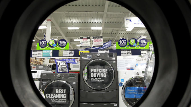 FILE - In this Monday, Sept. 10, 2012 file photo, dryers are seen from the inside of another clothes' dryer, foreground, at a Lowe's store location, in Framingham, Mass. Lowe's Cos. Inc. reports quarterly financial results before the market opens on Wednesday, May 22, 2013. (AP Photo/Steven Senne, File)