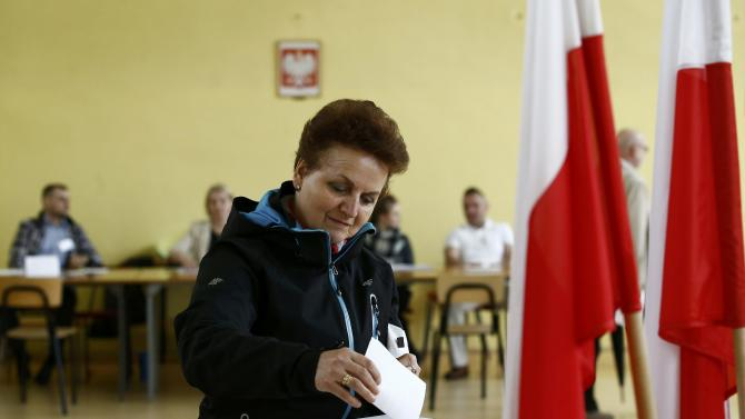 Woman casts her vote in a polling station in Warsaw