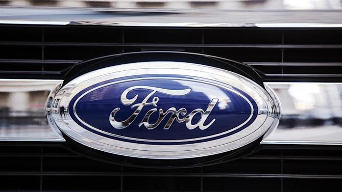 A Ford logo is seen on the grill of a 2015 F-150 truck outside the New York Stock Exchange in the Manhattan borough of New York