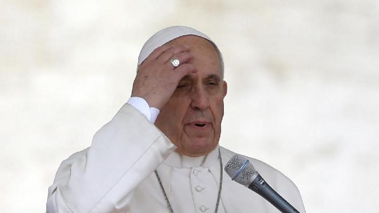 Pope Francis does the sign of the cross during his weekly general audience, in St. Peter's Square, at the Vatican, Wednesday, April 23, 2014. (AP Photo/Andrew Medichini)