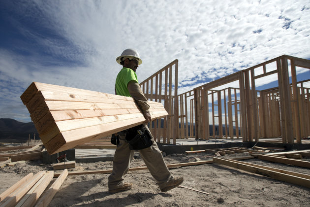 <p>               In this Friday, Nov. 16, 2012, photo, construction worker Miguel Fonseca carries lumber as he works on a house frame for a new home  in Chula Vista, Calif. Confidence among U.S. homebuilders inched up in Novemeber to the highest level in more than six and a half years, as builders reported the best market for newly built homes since the housing boom.(AP Photo/Gregory Bull)